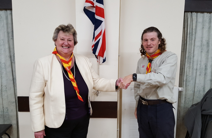 Heather Wheeler MP being instilled as an Honourary Scout in the 1st Hartshorne Group by Leader, Tim Moore, at Goseley Community Centre